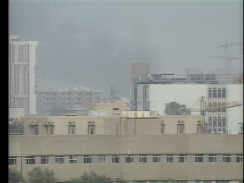 smoke rises over buildings in baghdad during operation desert shield. - baghdad stock videos & royalty-free footage