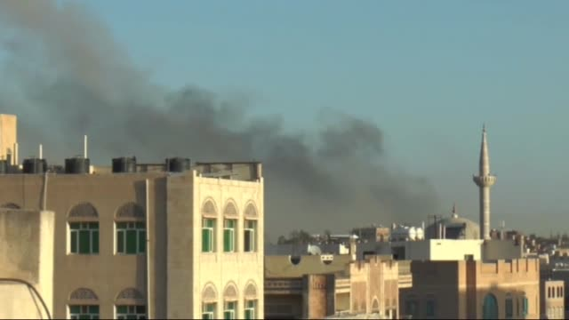 smoke rises over the military base under the control of the houthis after the war crafts belonging to the saudi-led coalition bombed there in sanaa,... - bomb stock videos & royalty-free footage