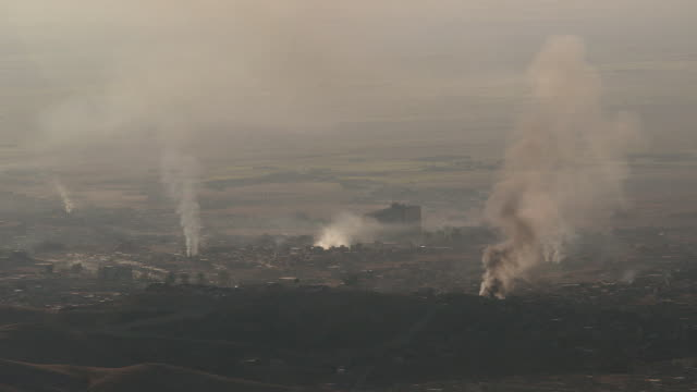 smoke rising after fighting in sinjar iraq - sinjar stock videos & royalty-free footage