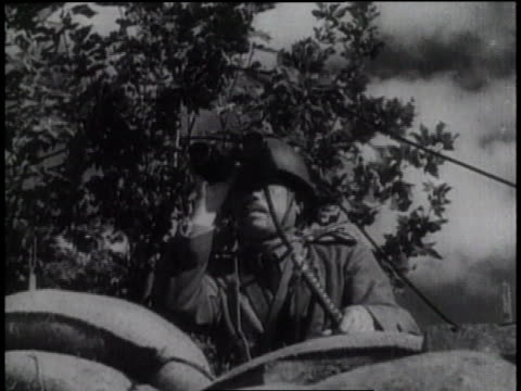 vidéos et rushes de smoke rising and soldiers marching / fire burning and soldiers marching / men tied to a post / soldier waving a japanese flag - 1931