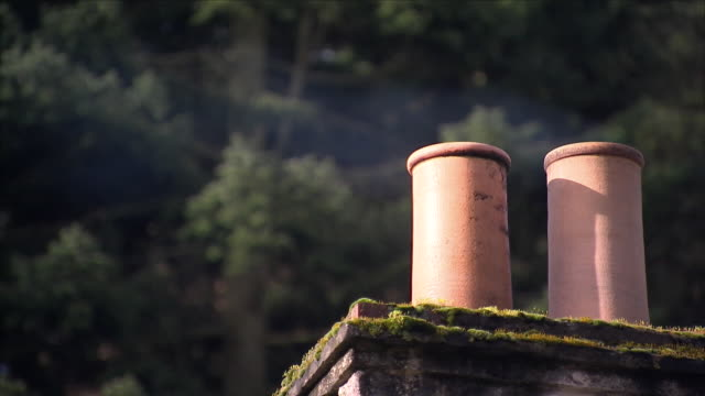 smoke rising from a rural chimney - remote location stock videos & royalty-free footage