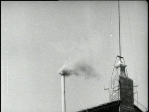 vídeos de stock e filmes b-roll de smoke rising from a small smokestack signals the selection of a new pope after the death of pope pius xii - escolha