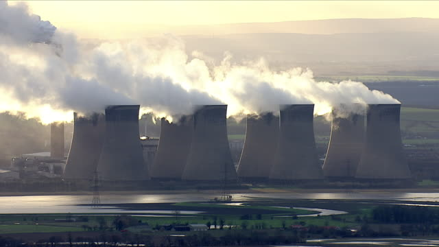 smoke rising from chimneys of a coal power plant - coal stock videos & royalty-free footage