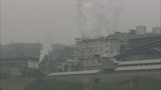 la ws smoke rising from factory / china - chimney stock videos & royalty-free footage