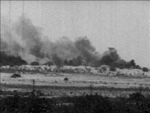 pan smoke rising from hills in desert in six day war / newsreel - 第三次中東戦争点の映像素材/bロール