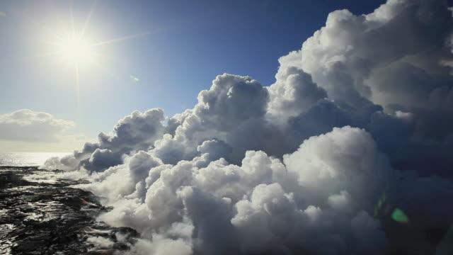 ws smoke rising from kilauea volcano at sunrise / kalapana, hawaii, usa - lava stock-videos und b-roll-filmmaterial