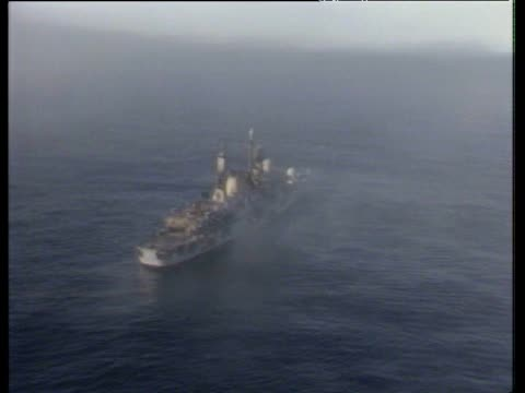 smoke rising from severely damaged hms sheffield following strike by exocet missile during falklands conflict; 7 may 82 - 1982 stock videos & royalty-free footage