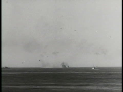smoke rising from water. xws explosion on water. airplane in flight british allied pom-pom anti-aircraft guns rapid firing & rotating on deck of... - world war one stock videos & royalty-free footage