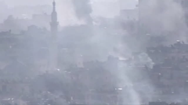 smoke rising in aleppo after rebels set fire to their headquarters and fuel supplies - syrien stock-videos und b-roll-filmmaterial