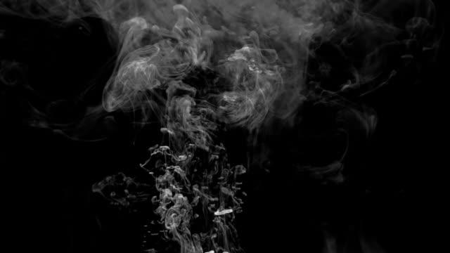 HD smoke rising on black