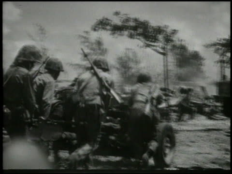 smoke rising on west coast 2nd marine division advancing into capital city of garapan engaging in street fighting ducking from explosion firing... - saipan stock videos and b-roll footage