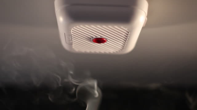 Smoke rising up to smoke alarm, UK