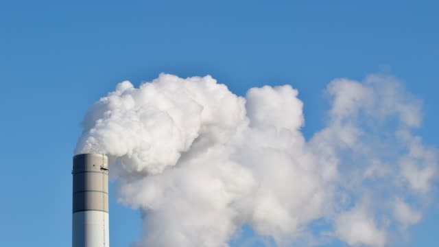 Smoke stack against sky