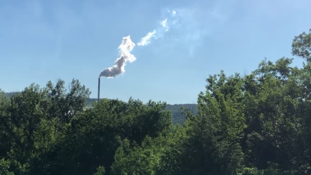 smoke stack from mill releasing smoke into atmosphere - maine stock videos & royalty-free footage