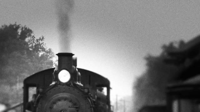 stockvideo's en b-roll-footage met smoke stack of steam engine train - locomotief