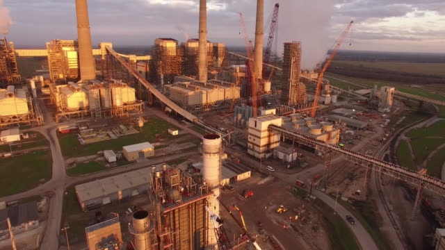 smoke stack small orbit, drone 4k industry aerial video, power plant coal, natural gas, wind farm, renewable energy, smokestack, - braun stock-videos und b-roll-filmmaterial