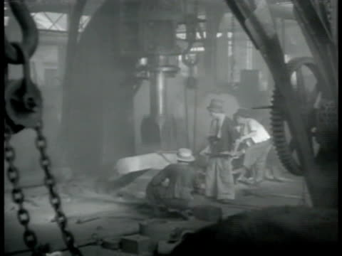 smoke stacks of foundry ha ws chinese workers entering gate int vs workers at machine press ms loom worker ha ws loom machines vs woman working... - foundry worker stock videos and b-roll footage
