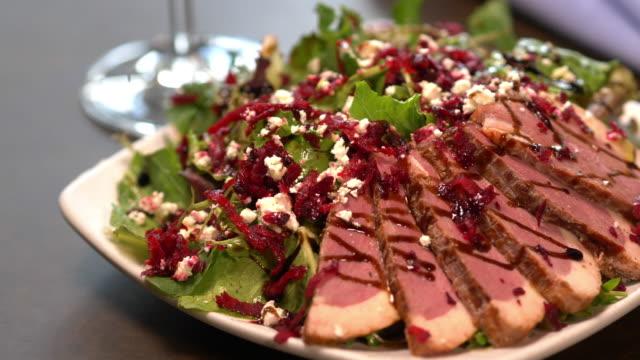 smoked duck breast salad with beets, cranberries, feta, arugula. - feta stock videos & royalty-free footage