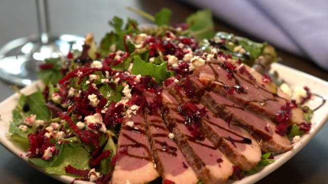smoked duck breast salad with beets, cranberries, feta, arugula. - agritourism stock videos & royalty-free footage