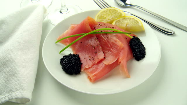 smoked salmon & caviar rotate on a white plate with lemon & dill - dill stock videos and b-roll footage