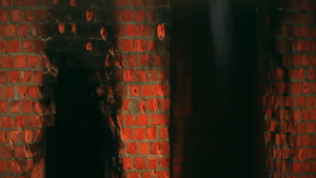 smoked walls inside brick building. shoot with anamorphic lenses - burnt stock videos & royalty-free footage