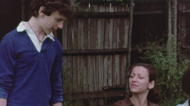 1978 pan a smoker getting homework help from a friend, then turning him down for a date / united kingdom - 1978 stock videos and b-roll footage