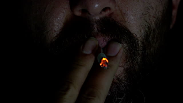 smoker in the dark - one mature man only stock videos & royalty-free footage