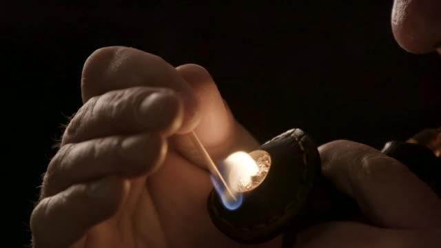 Smoker lights a pipe