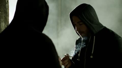 stockvideo's en b-roll-footage met rokers - drug gefabriceerd object