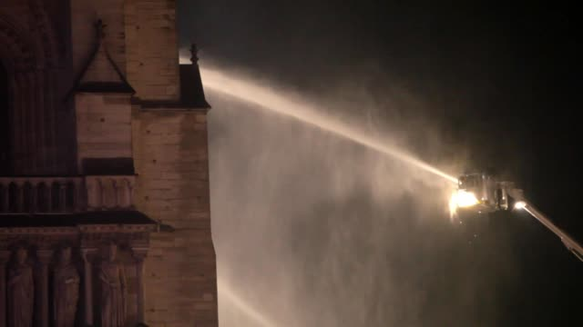 smokes and flames rise during a fire at notre-dame cathedral in central paris, france, on april 15, 2019.- a fire broke out at the landmark... - notre dame de paris stock videos & royalty-free footage