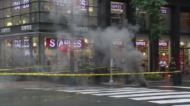 smokes come out of manholes on e 43st and 3rd avenue during a rainy weather in new york usa on july 31 2019 - exploding stock videos & royalty-free footage