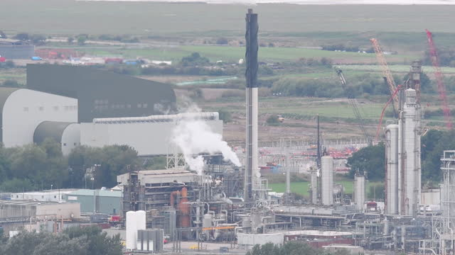 smokes stacks emitting steam at the cf industries holdings inc. in ince, uk, on thursday, september 16, 2021. the cf industries holdings inc.... - industry stock videos & royalty-free footage