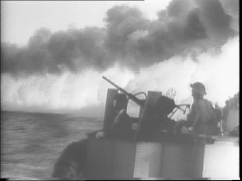 smokescreens on pantelleria island to protect the navy ships / german planes fire on the allied ships ships exchange fire / assault boats head for... - 1943 stock videos & royalty-free footage