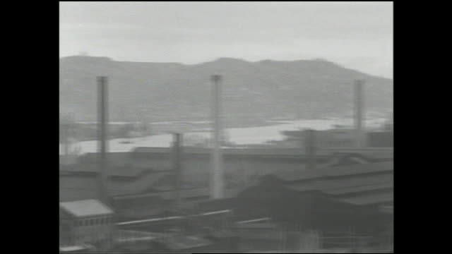 Smokestacks tower above steel mills in the Dokai Bay area.