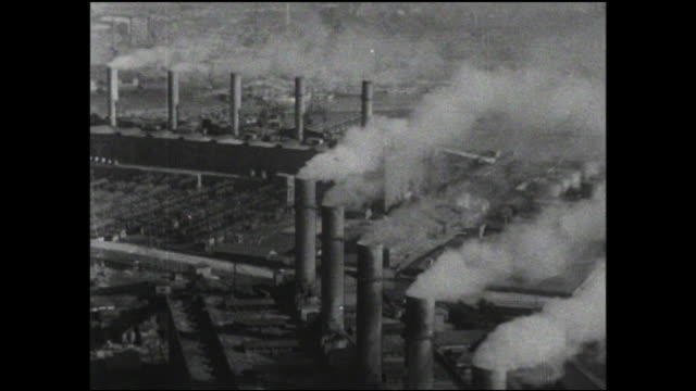 smokestacks vent pollution from production facilities in an industrial area of osaka bay. - showa period stock videos & royalty-free footage
