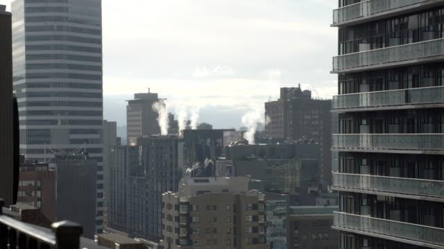 smokey city blocks / toronto, canada - campo totale video stock e b–roll