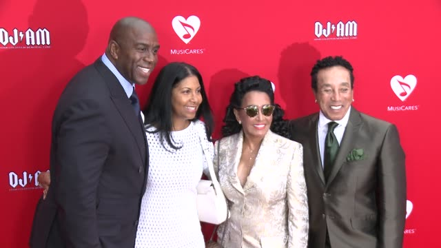 smokey robinson and earvin 'magic' johnson at the 12th annual musicares map fun benefit concert honoring smokey robinson at the novo by microsoft on... - smokey robinson stock-videos und b-roll-filmmaterial