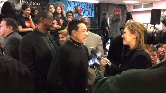 smokey robinson appearing at pio pico middle school to deliver musical instruments and one million dollar check donated by niagara cares to support... - smokey robinson stock-videos und b-roll-filmmaterial