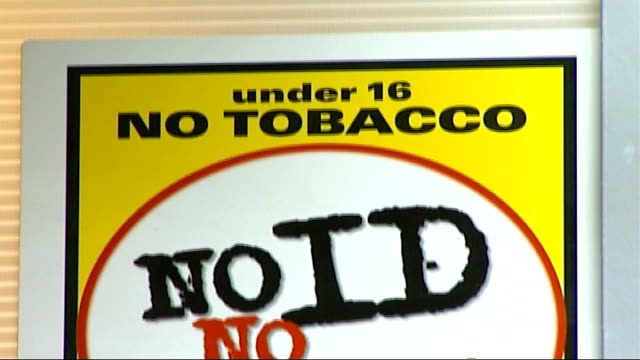 age limit for purchasing tobacco to rise from 16 to 18; england: int citizencard poster with warning sign 'no id no sale' tilt down - no smoking sign stock videos & royalty-free footage