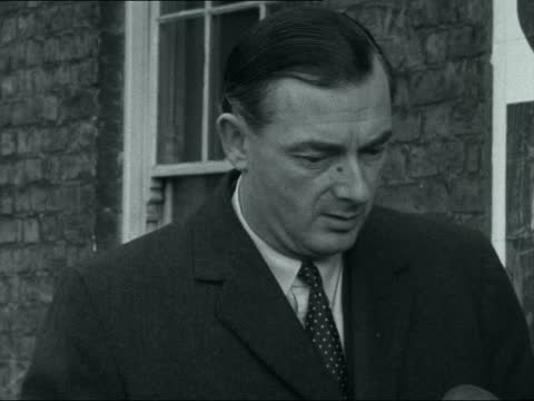 stockvideo's en b-roll-footage met smoking and driving; england: ext 'mr priestley' out of car, lighting pipe and interview sof. - 16mm neg itn 1.09mins tx 7.2.61/5:55pm 22409 - itv evening bulletin