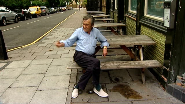 cash incentive to quit in dundee; england: london: ext man sitting outside pub as finishes cigarette and throws it away - スコットランド ダンディー点の映像素材/bロール