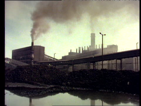 Smoking chimney and run down steel works, Poland