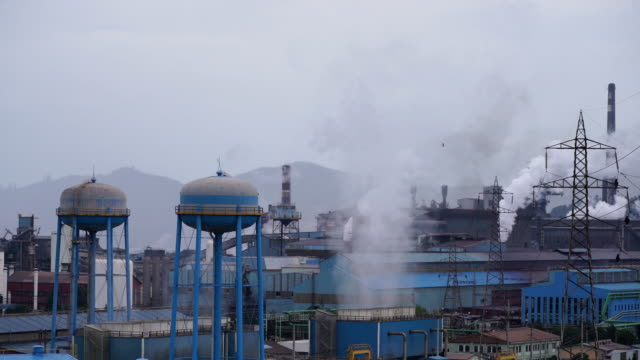 smoking chimneys of a factory - ozgurdonmaz stock videos and b-roll footage
