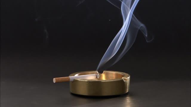 CU Smoking cigarette with golden ashtray / Vienna City, Vienna, Austria