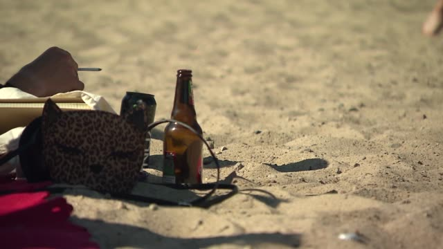 smoking cigarettes and drinking alcohol on beach - beer bottle stock videos & royalty-free footage
