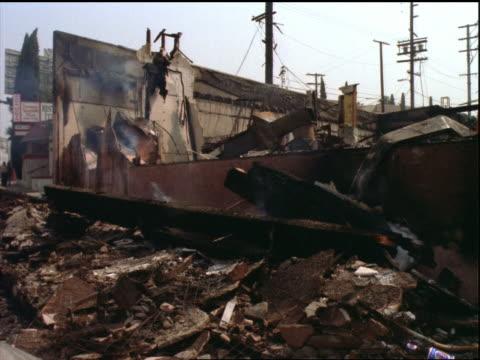smoking destruction of burnt building / los angeles riots - 1992 stock videos & royalty-free footage