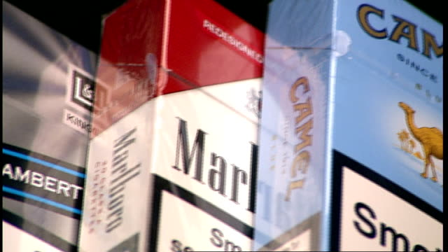 government plans for plain cigarette packets; date unknown england: int close shots different brands of cigarette packets - sachet stock videos & royalty-free footage