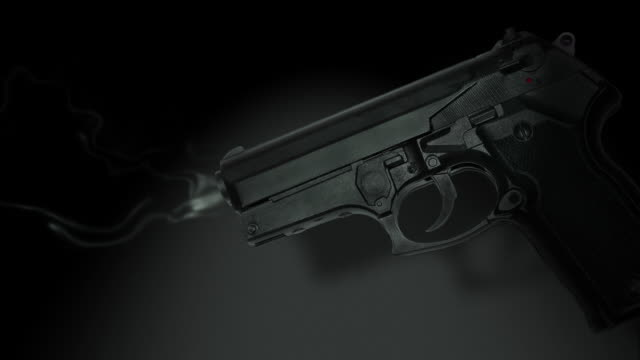 vídeos de stock, filmes e b-roll de cgi, smoking gun against black background - smoking