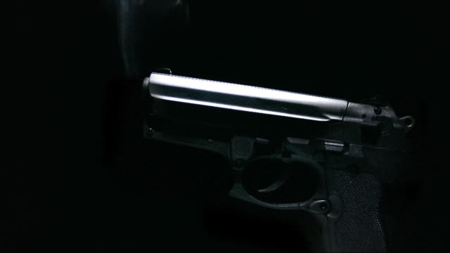 cgi, smoking gun against black background - handgun stock videos & royalty-free footage