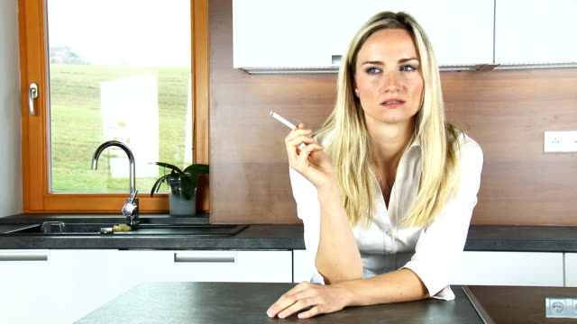 smoking in the kitchen - smoking issues stock videos and b-roll footage